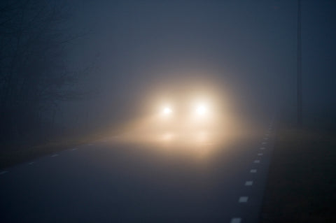jeep driving at night with fog lights on