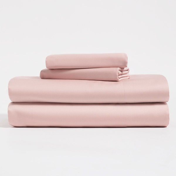 Salmon pink, Lyocell Cotton sheet set, including flat sheet, fitted sheet, and two pillow cases.