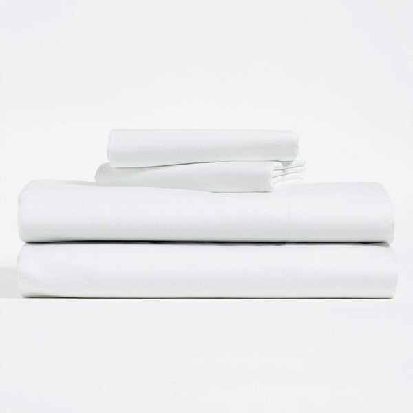 White, Lyocell Cotton sheet set, including flat sheet, fitted sheet, and two pillow cases.