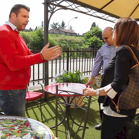Marco and Alice Margaritelli visiting the outdoor showroom of their hand painted tables supplier in Deruta-Italy.