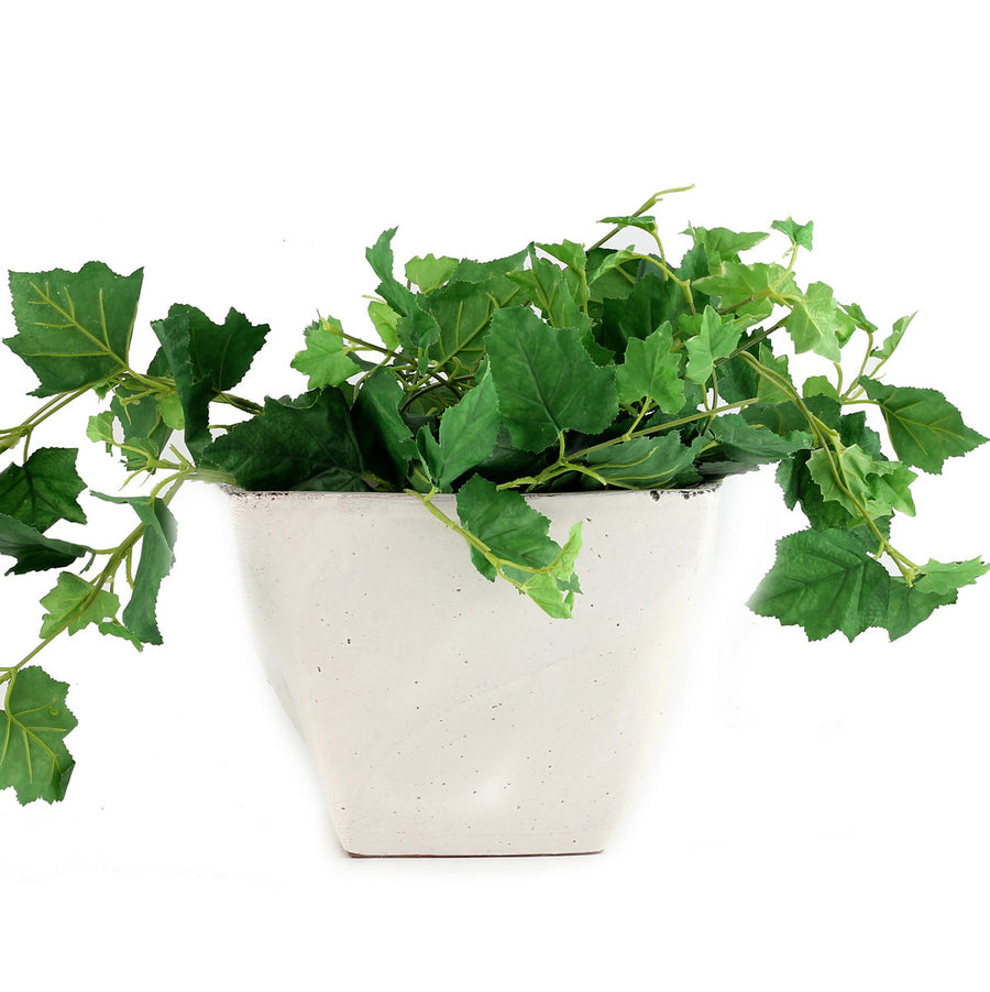 SCAVO BIANCO: Square Jardiniere planter with wave design