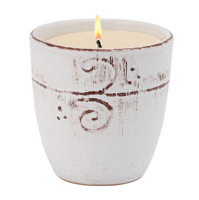 NATURA: Large Candle with bass relief tree branches motif hand finished in a whitewash glaze.