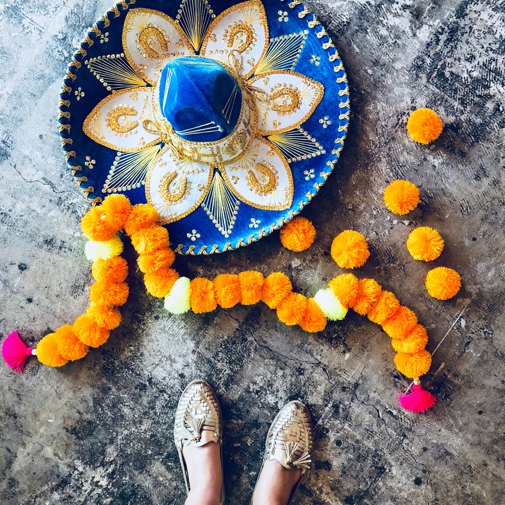 DIY with The Neon Tea Party: Mexican Marigold Pom Pom Garland How-To
