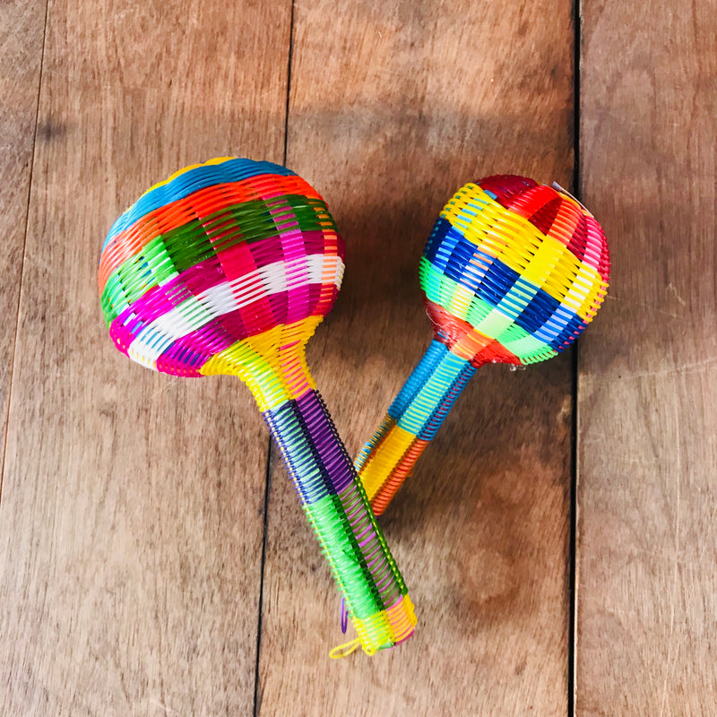 Mexican baby rattle woven with colorful plastic.