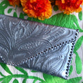 Silver embossed leather envelope-style clutch