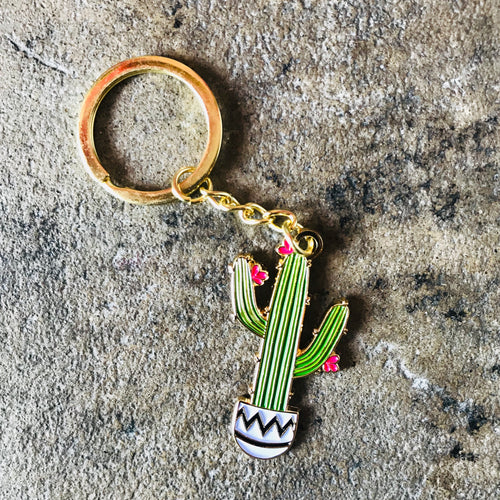 Enamel keychain of a green Saguaro cactus in a black and white pot
