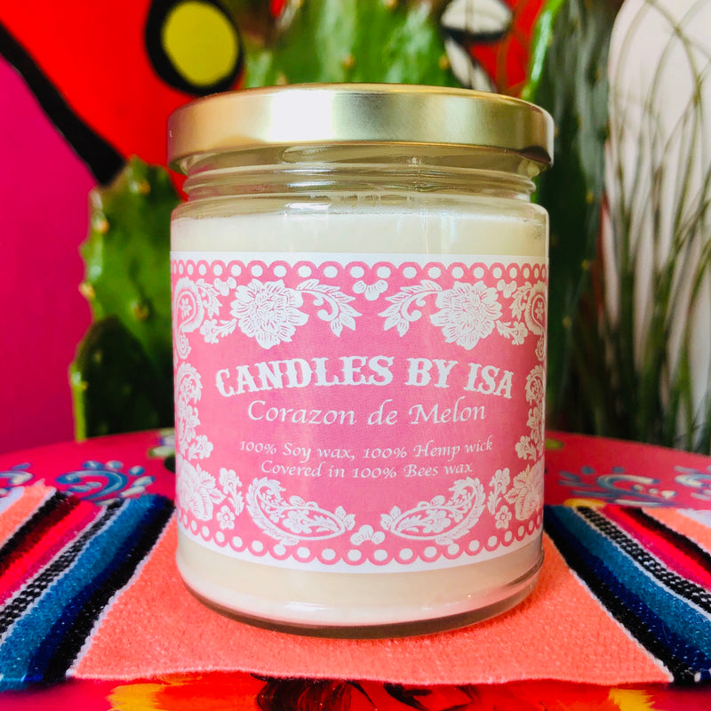 Corazon de Melon scented candles by Isa in a glass jar with lid and pink label