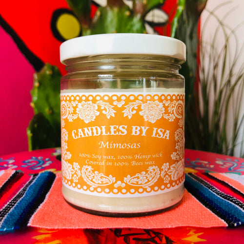 Mimosa scented candles by Isa in a glass car with lid and orange label