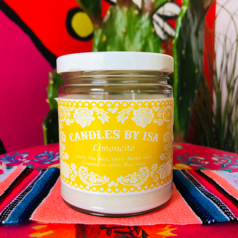 Lemoncito scented candles by Isa in a glass jar with lid and yellow label