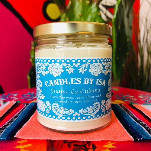 Juana la Cubana scented candles by Isa in a glass jar with lid and blue label