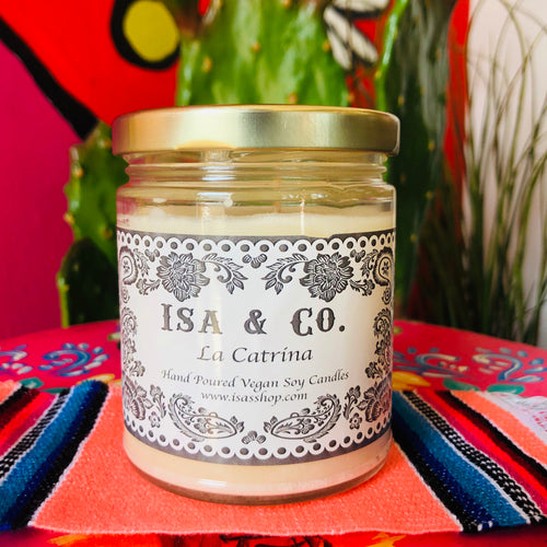 La Catrina scented candles by Isa in a glass jar with lid and white and black label