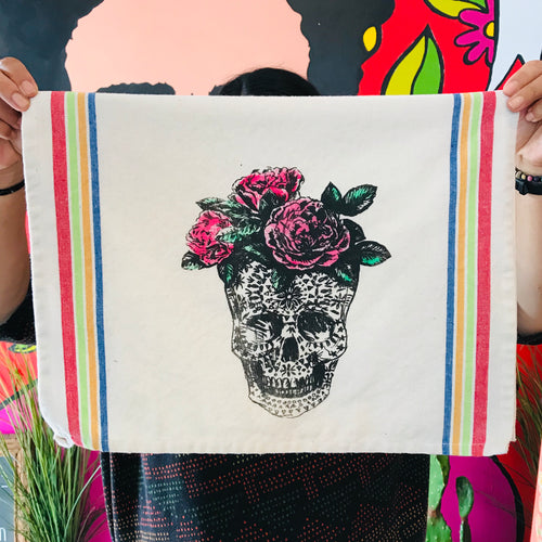 Loteria themed dish towels of a skull/la calavera and roses on its head