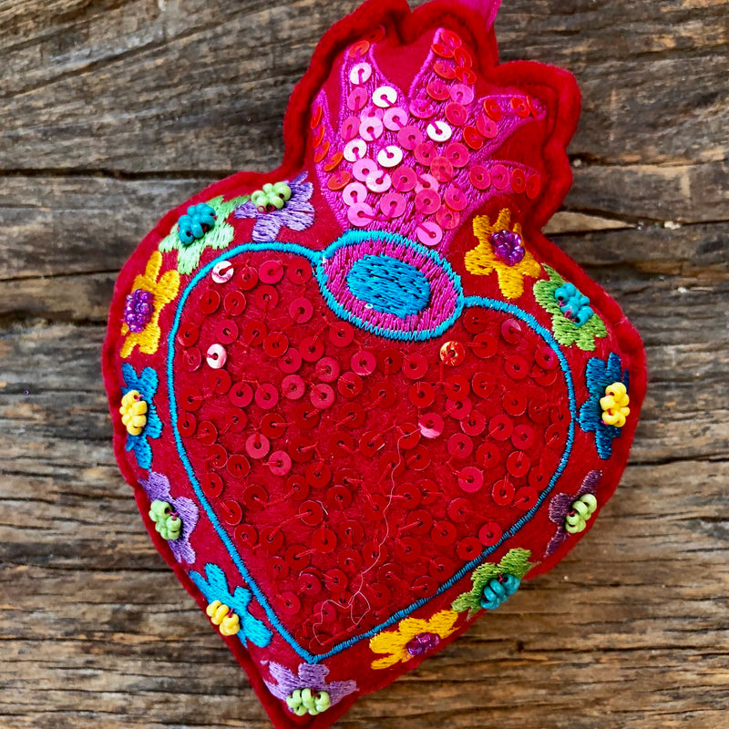 Felt embroidered plush heart with beading and sequin detailing