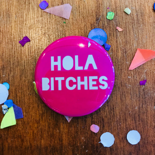 Pink Hola Bitches pin-back button made by Artelexia