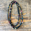 Blacked beaded necklace with multicolored beads throughout