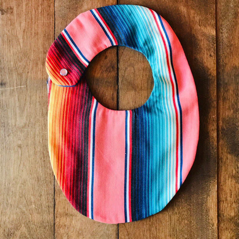 Coral serape striped baby bibs made from authentic Mexican serape blankets