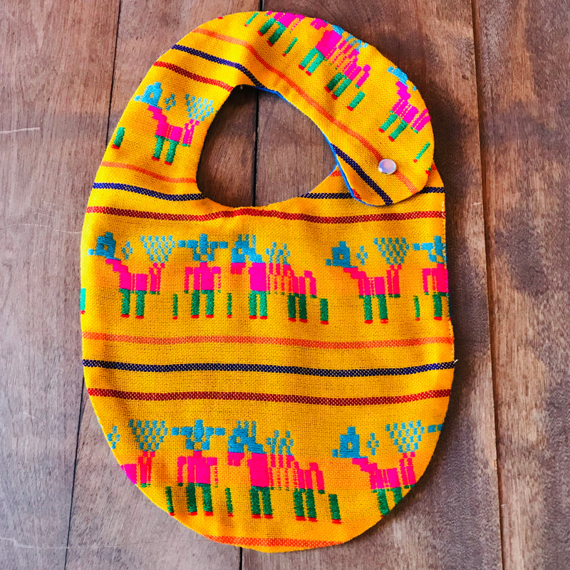 Yellow donkey printed baby bibs made from authentic Mexican Cambaya fabric