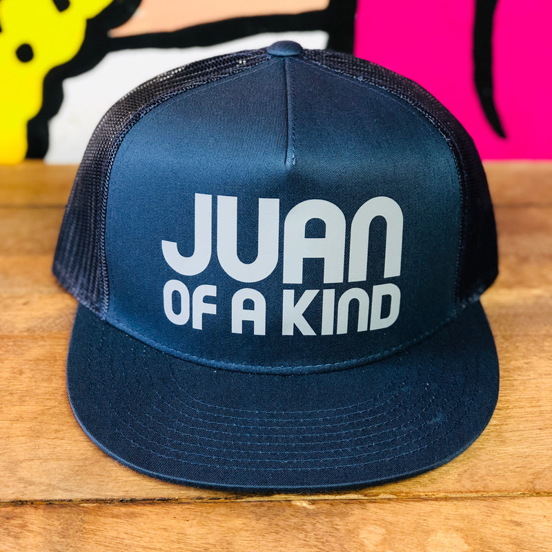 Juan Of A Kind navy trucker style hat.