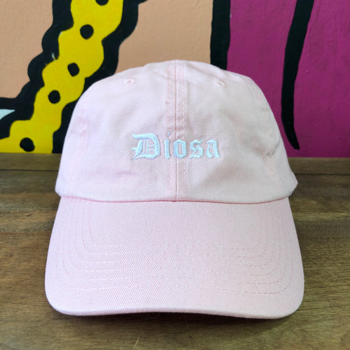 "Baby Pink baseball cap/hat with white ""Diosa"" lettering on the front"