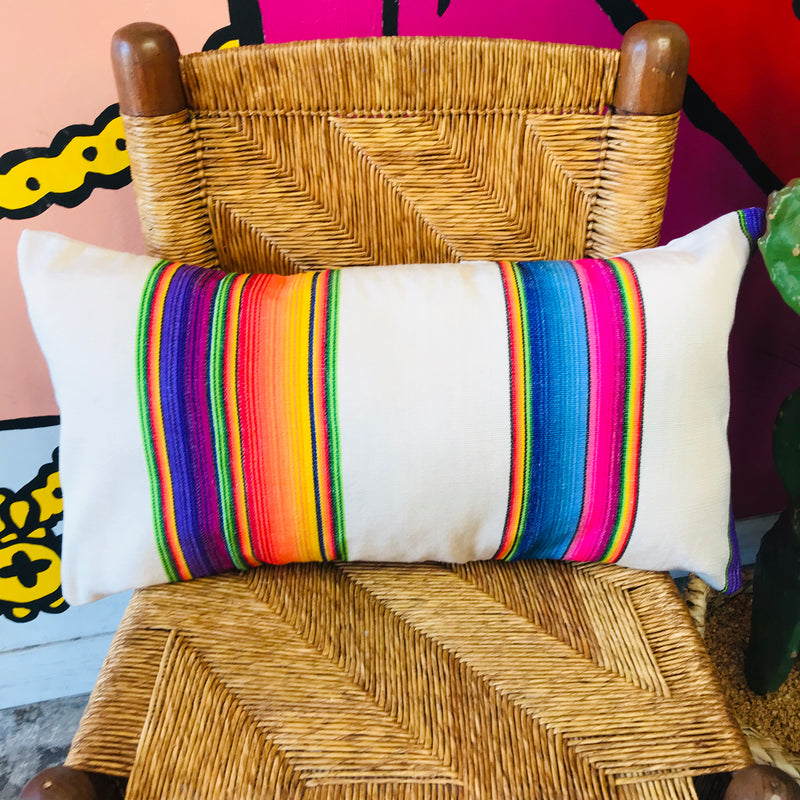 Rectangle serape printed pillowcase with bright multi-colored stripes.