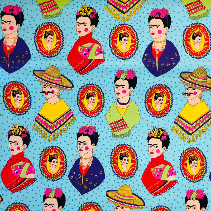 Alexander Henry Fabrics in Fantastico Frida pattern. This pattern has multiple Frida's  dressed up in different costumes against a teal background