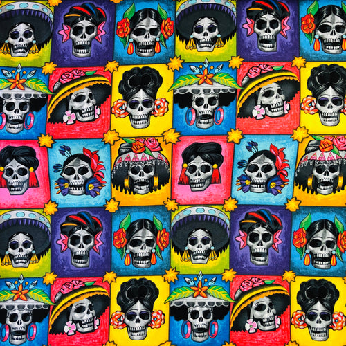 Alexander Henry Fabrics in Las Señoras Elegantes pattern. This pattern has different La Catrina señoritas in each colorful square block.