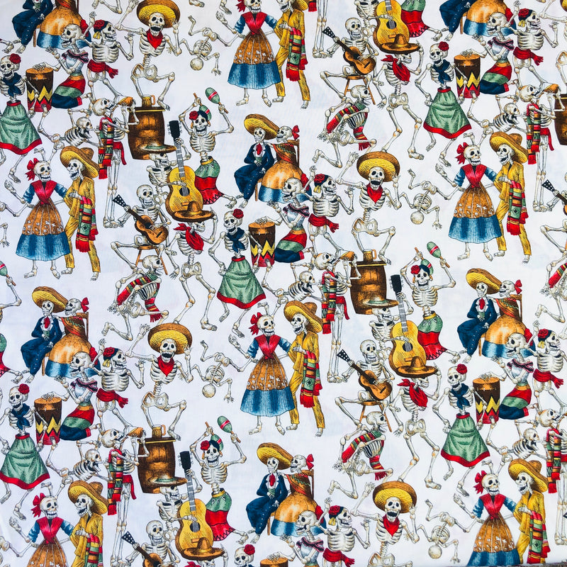 Alexander Henry Fabrics in Fiesta de los Muertos pattern. This pattern has multiple skeletons partying against a white background