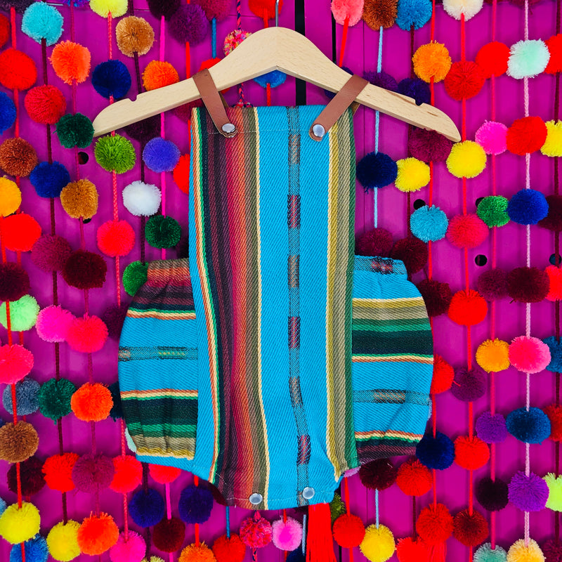 Mexican style serape baby romper with leather straps in turquoise color