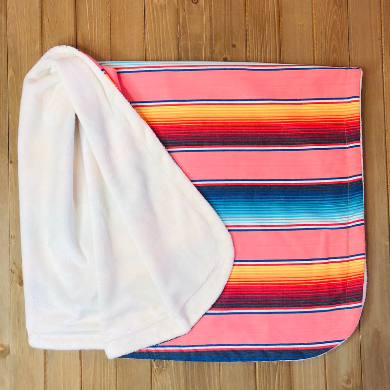 Mexican style serape baby blanket with minky backing in coral color