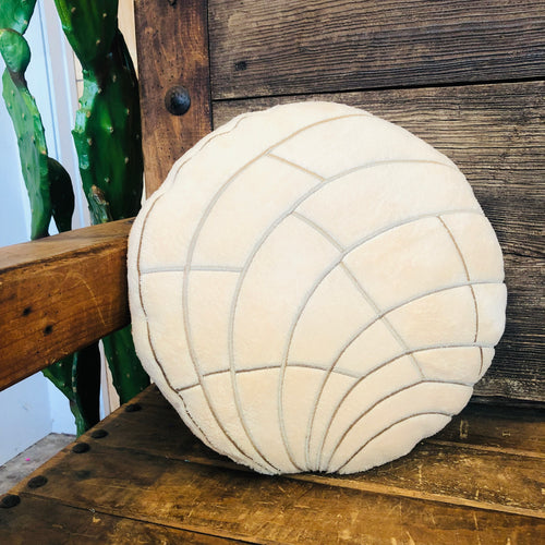Plush tan concha pillow for the home