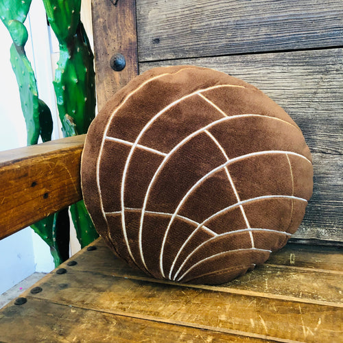 Brown plush concha pillow for the home.
