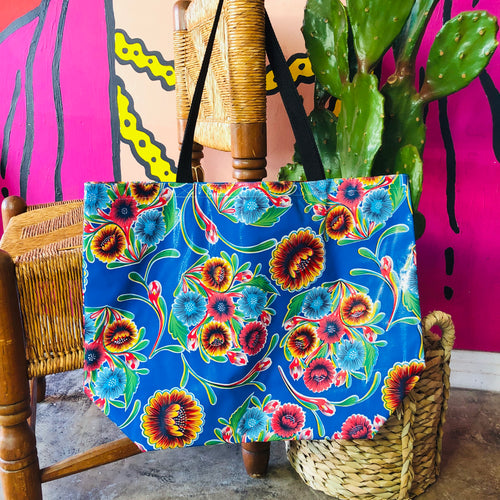 Large blue Mexican floral oil cloth tote bag.