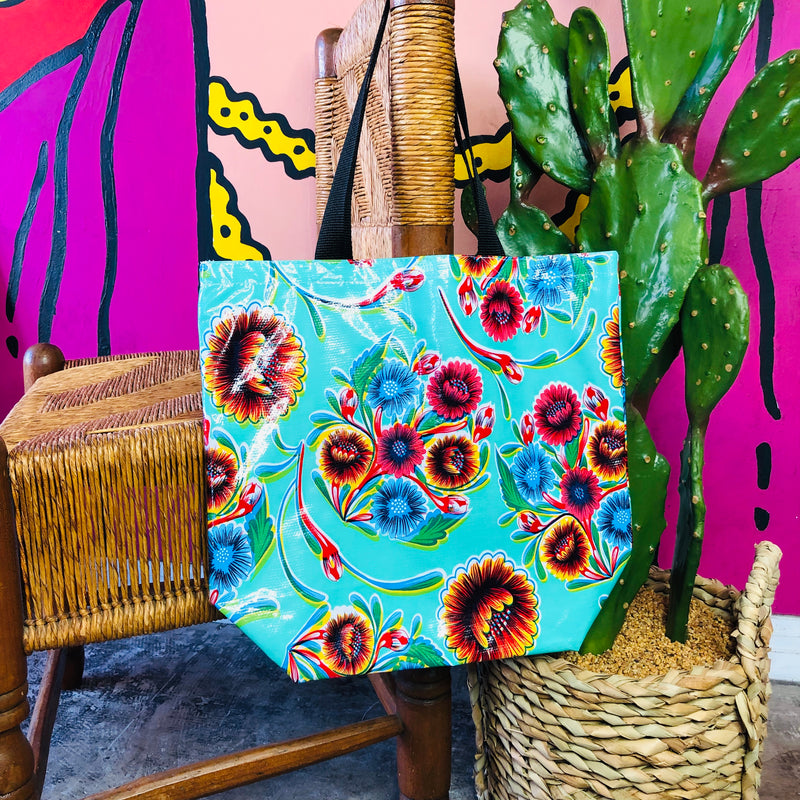Turquoise floral oil cloth tote bags