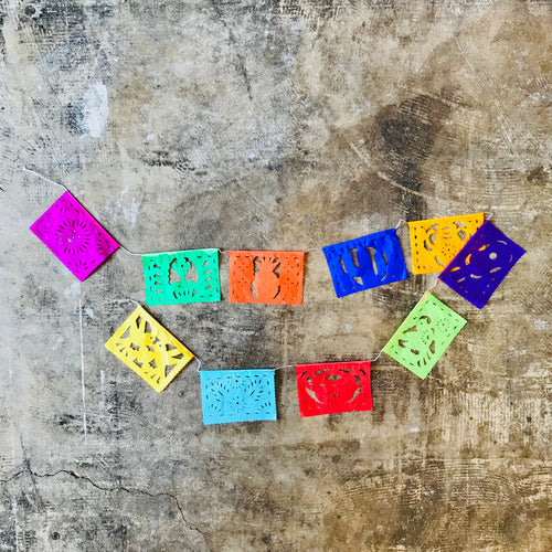 Colorful papel picado banners in a mini size. This is perfect for decorating your home, parties, fiestas, Dia de los Muertos altars and adding some festive flair.