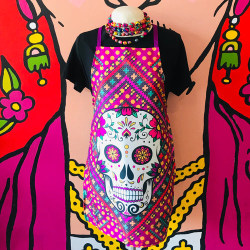 Mexican Pop Art aprons with a floral calavera against a stitched pink background