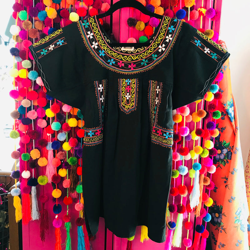 Women's traditional Mexican embroidered blouse with neon embroidery