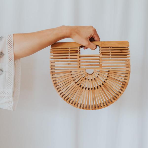 Inspired by a Japanese picnic bag from the 70's and reborn as a handbag, the beauty of this semi-circle shape bag is in its emptiness.