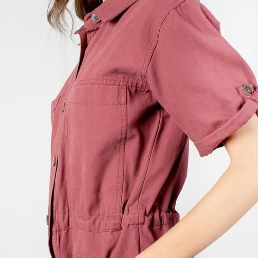 Women wearing burgandy short sleeve jumpsuit