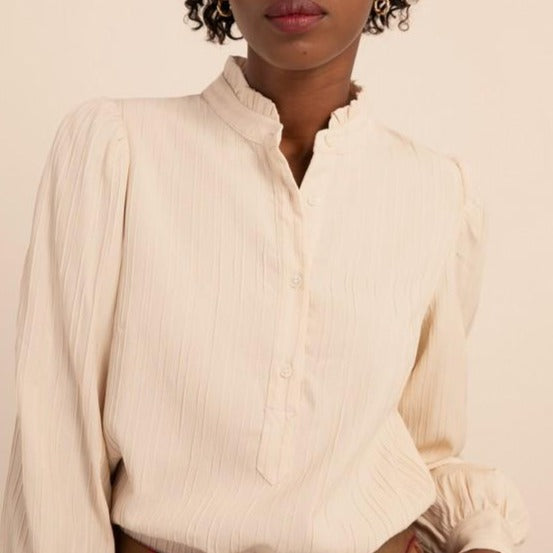 Women wearing peasant button up blouse