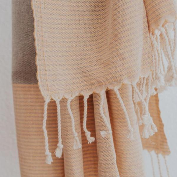 Close up of Bon Ton Studio Flora Turkish Towel in Caramel color