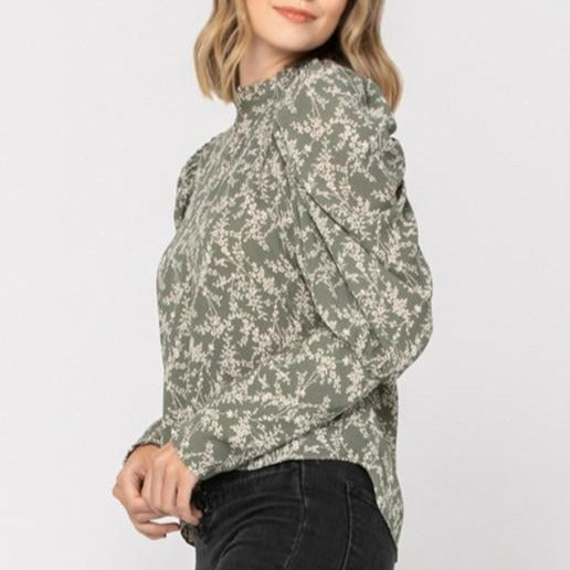 Women wearing floral puff sleeve blouse