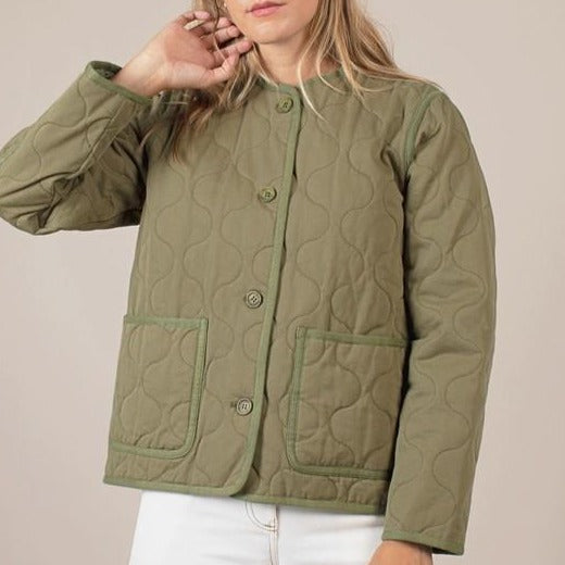 Women wearing quilted layering olive green jacket