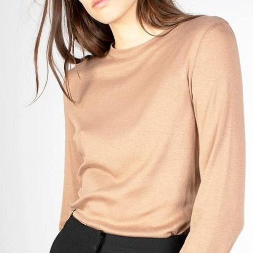 Women wearing long sleeve camel crew neck tee