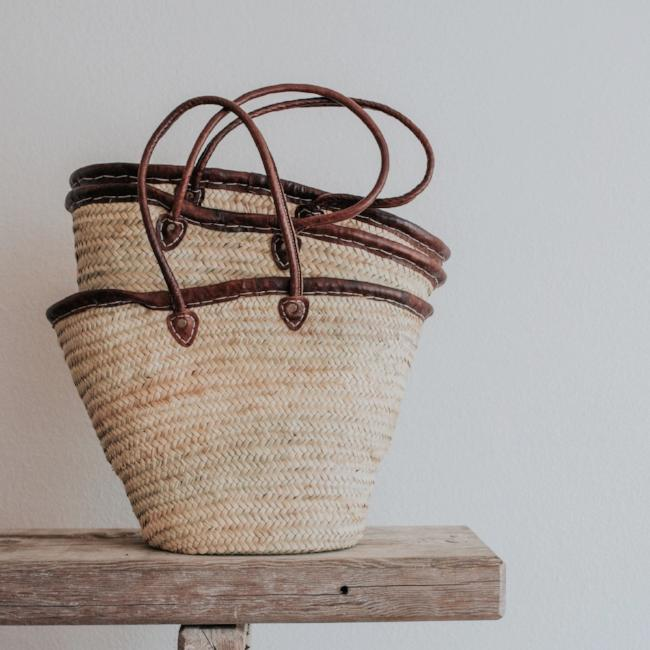 Made in Morocco and featuring leather handles, our handwoven straw tote is the perfect size carryall for your market haul, weekend away or as an everyday purse.