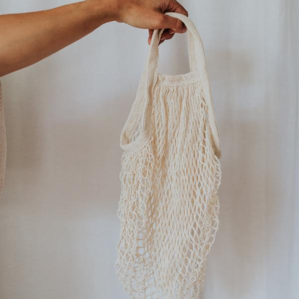 Soft and expandable in natural cotton, this bag stows away easily for travel and is comfortable to sling over the shoulder even when filled to the brim.  Here's a tip: get some zip pouches to hold your smaller things.