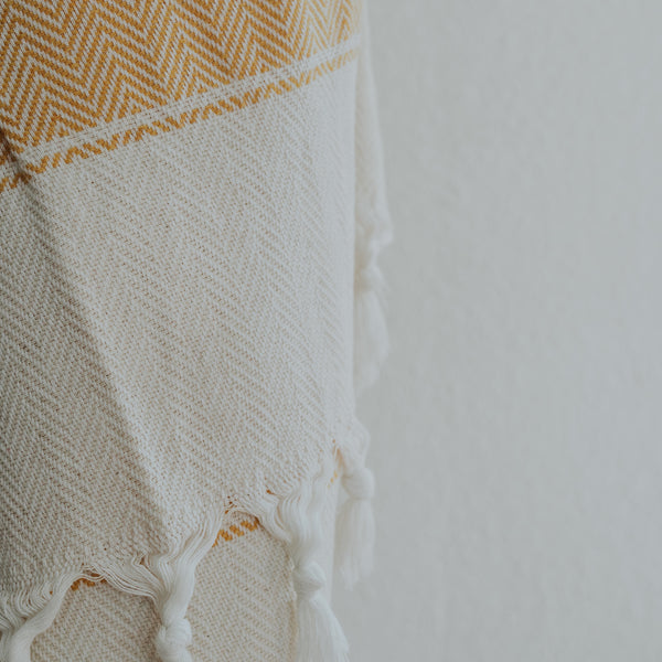 Close up of Bon Ton Studio Flora Bodie Towel in Marigold color