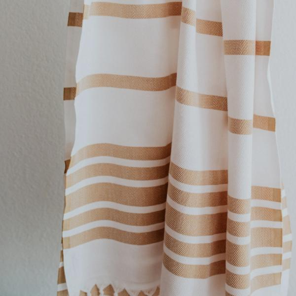 Close up of Bon Ton Studio Greta Turkish Towel in Marigold color