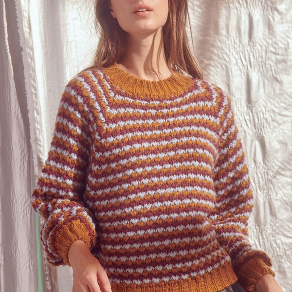 Women wearing multi color striped knit sweater