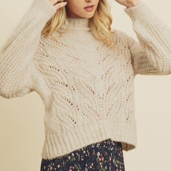 Women wearing knit mock neck sweater