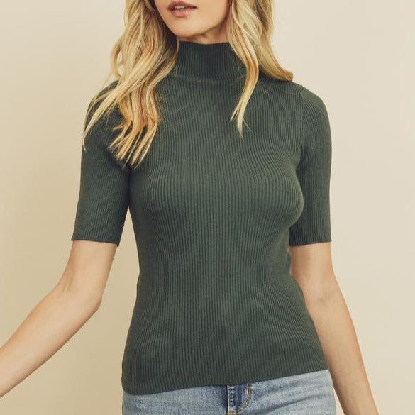 Women wearing ribbed knit olive mock neck top